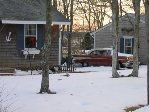 Photo of snowy house and car on Cape Cod.