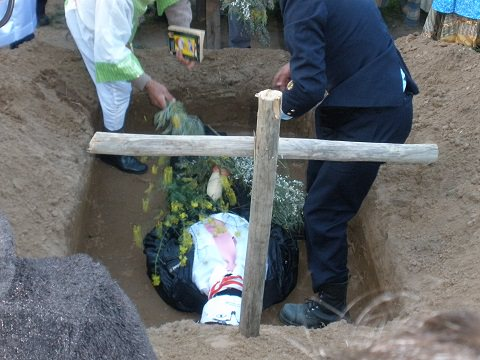 "The ""body"" being buried"
