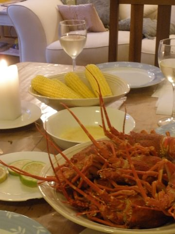 Cooked crayfish, corn and sauce on the table.