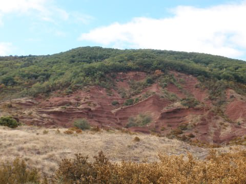 A photo of the red soil & rocks at Lake Salagou.
