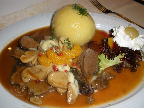 Roast wild boar, dumpling and mushroom sauce.