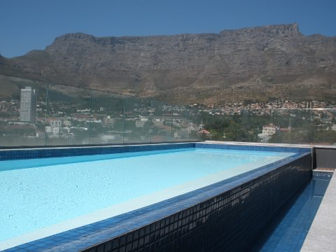 The swimming pool on the roof of the hotel.