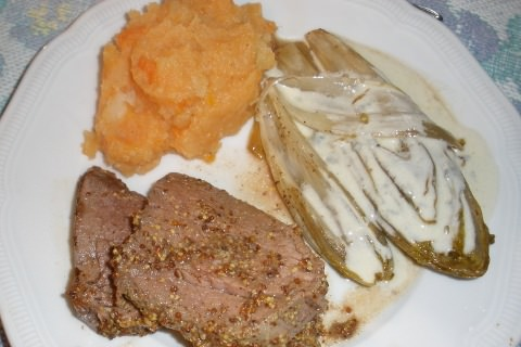A photo of Beef filet, mash potatoes & root vegetables, and blue cheese endives.