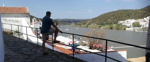 Overlooking both villages and the river and footbridge, Festival do Contrabando