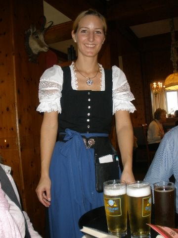 A photo of a waitress in a traditional dirndl.