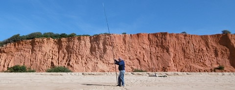 A fisherman in front of Red Rock